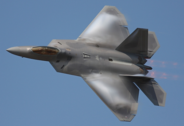 A AIM-120 AMRAAM capable F-22 performs a fly-by